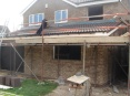 Two storey side extension including garage, combined with single storey rear kitchen extension