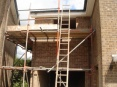 Two storey side extension with garage showing added fascia and soffit boards