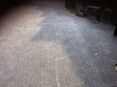 200msq area of charcoal block paving laid to form a camber to the driveway (camber meaning a graduated curvature)