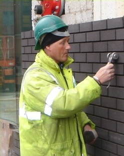 David doing a bricklaying job in Sheffield city center