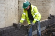Office wall in Sheffield being built by a bricklayer in 2009