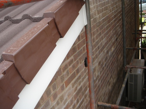 Dry ridge pack added to tile ends on roof of kitchen extension